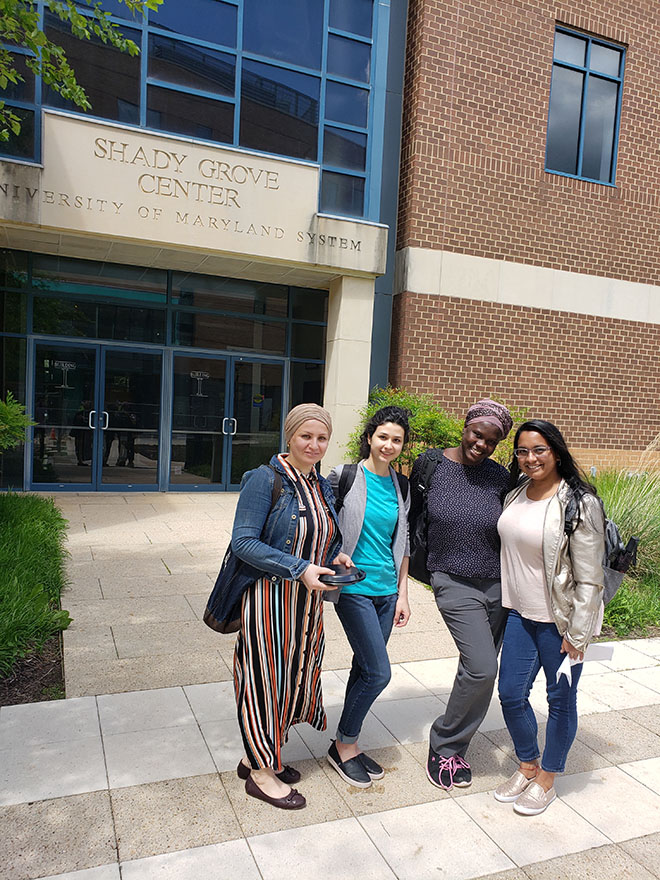 Student pharmacists pose for group photo during last day of classes at Universities at Shady Grove.